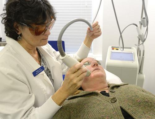 Nurse Sally performing ExcelV Laser Treatment